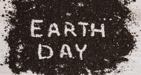 """The words """"earth day"""" written in soil"""