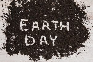 "The words ""earth day"" written in soil"
